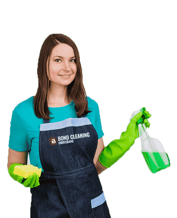 young woman in blue shirt and black apron standing with spray bottle and sponge in hand